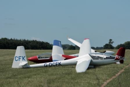 image of gliders parked on the ground